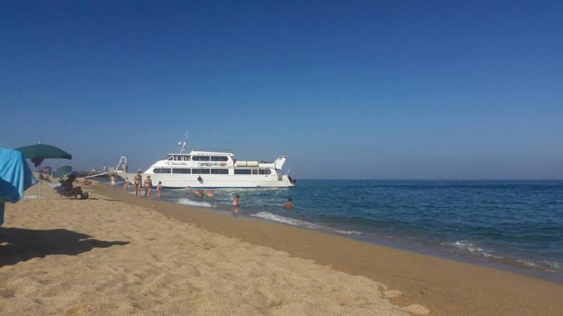 Davide motor ship boarding passengers in Orosei